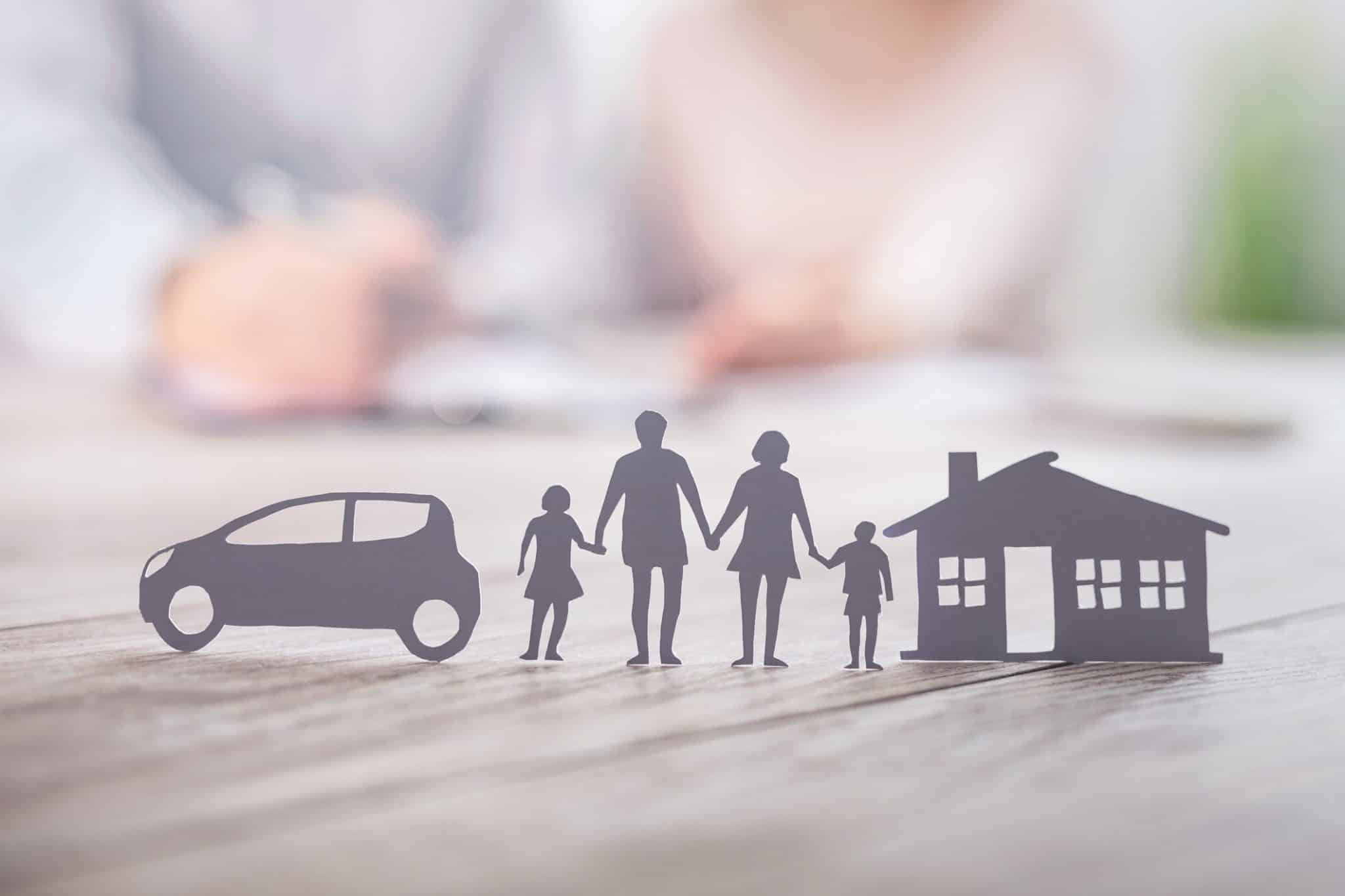 As you enter your 30s, your near-term responsibilities and long-term obligations expand. Starting a family, contemplating homeownership and earning enough money to consider investing all come with the territory and require a financial plan. A couple with a house, car and two kids is pictured.